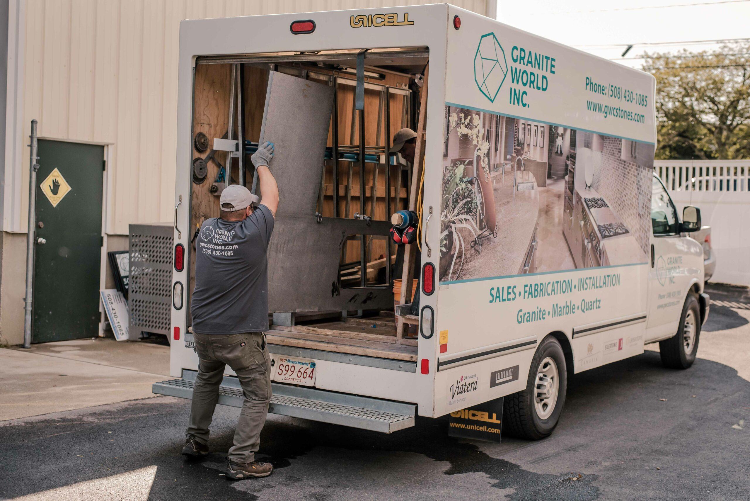 Granite World Employee Working on a countertop fabrication job, entering the GW truck