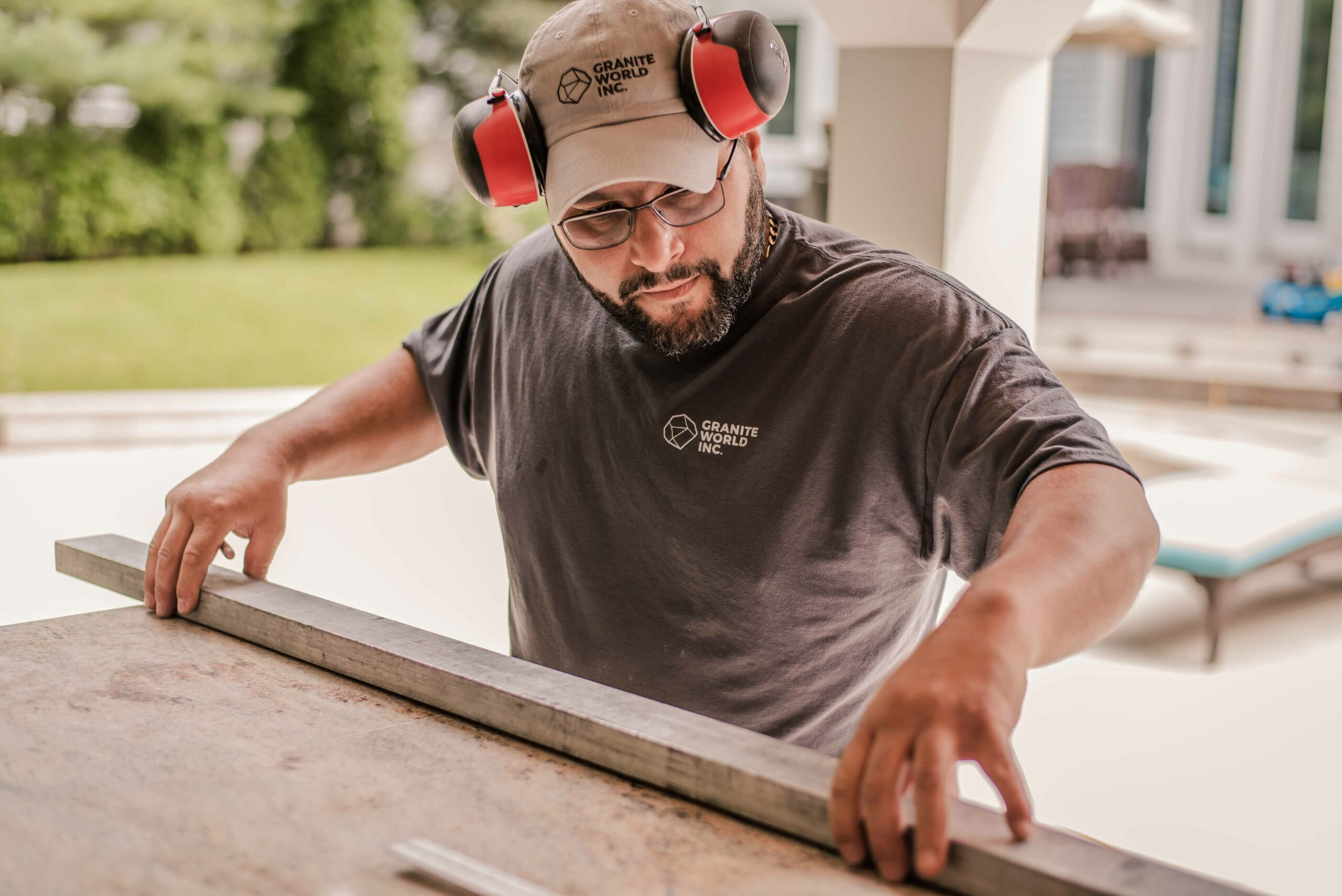 Granite World Employee Working on an outside countertop fabrication